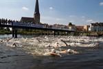 Ironman beim Warnowschwimmen 2013 in Rostock