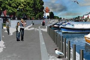 So soll die neue Sturmflutschutzmauer am Südende des Alten Stroma in Warnemünde aussehen - Visualisierung im Bereich eines Durchgangs (Quelle: Frank Schmidt-Garling)