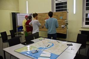Workshopteilnehmer diskutieren Umweltaspekte eines neuen Flächennutzungsplanes