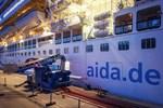 AIDAprima bezieht jetzt Landstrom in Warnemünde